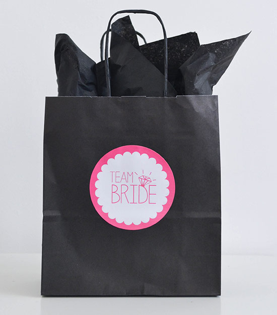 Black hen bag with label and tissue